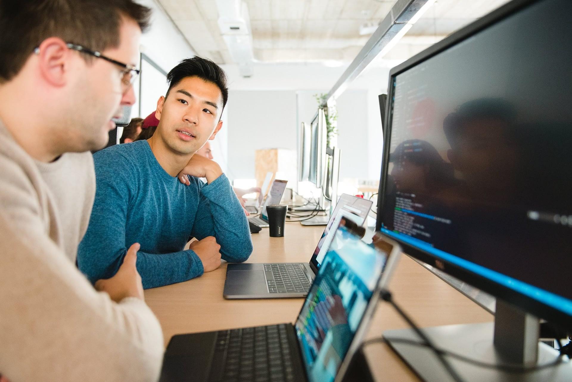 Students solve coding challenges together at Codeworks